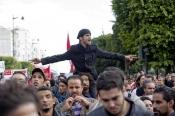 14-janvier-2012-:-Ramy-Sghaier;lun-des-leaders-de-la-contestation-révolutionnaire-est-porté-au-coeur-dune-manifestation-communiste-lors-de-la-Commémoration-à-Tunis-du-premier-anniversaire-de-la-Révolution-tunisienne;le-14-janvier-étant-la-date-de-la-fuite-de-lex-Président-vers-lArabie-Saoudide.